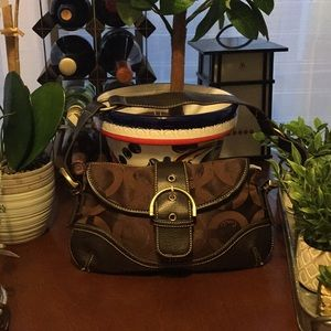 This Small Coach Handbag Is Like New Never Used.